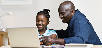 Dad and daughter with Computer
